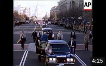 President George H.W. Bush and his wife Barbara walk along Pennsylvania Ave.